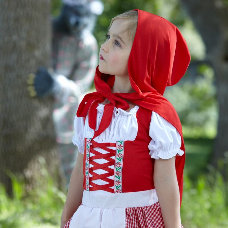 A lovely little red riding hood look. Your darling damsel will have no need for distress when wearing the Lil' Miss Red Costume which includes: A cherry red, peasant top dress with lace up bodice and attached apron. A cute cape is also included in this sweet storybook look. 2 piece set. Polyester. Hand Wash. Petticoat, Shoes and stockings are sold separately.