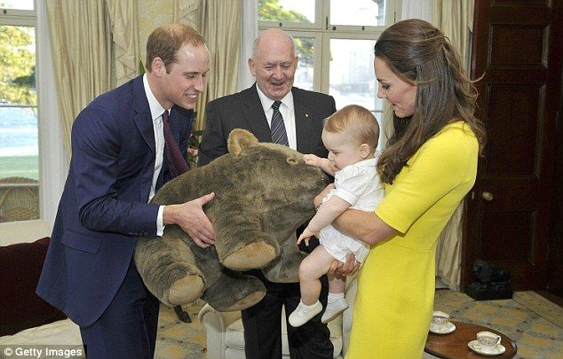 Playful: The new parents amuse their nine-month-old as he receives a gift from the Governo... http://dailym.ai/1f3IrKj#i-a9740e6c