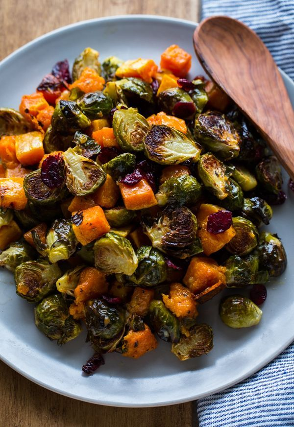 Roasted Brussels Sprouts and Squash with Dried Cranberries and Dijon Vinaigrette -- the perfect side dish for fall!