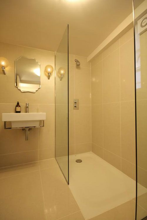 Shower trays can be sunk into the floor to avoid tiling costs whilst keeping the flush look between tiles and tray.  Showers, tiles, wet room trays, wastes and accessories at http://www.victorianplumbing.co.uk