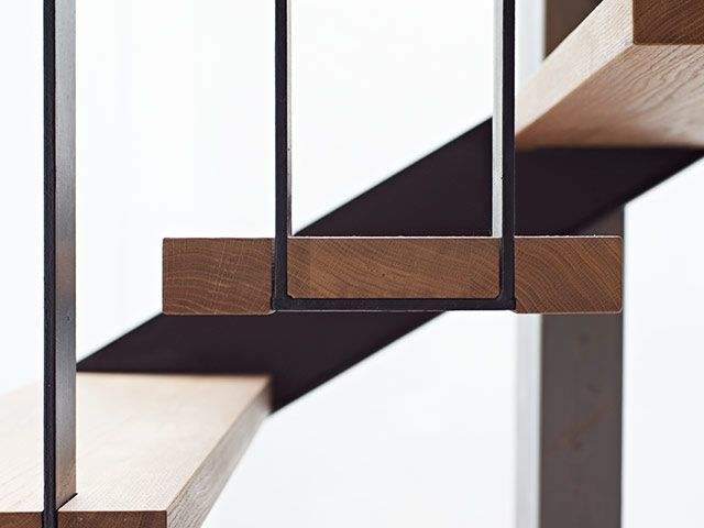 the suspended stairs corresponds with the bearing wood structure of House G