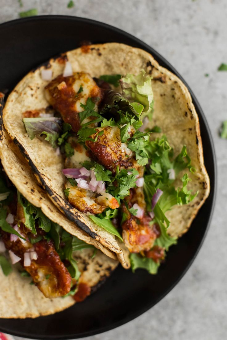 Garlicky Halloumi Vegetarian Tacos featuring fried halloumi cheese tossed with cilantro and garlic | @naturallyella