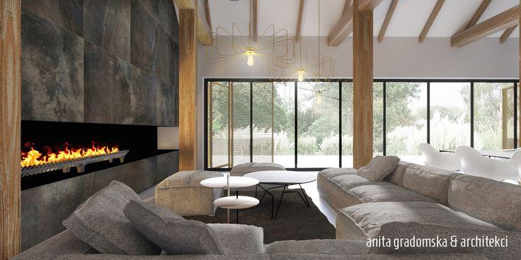 MARIAŻ NOWOCZESNOŚCI Z TRADYCJĄ Eufeminów 236 mkw Jednoprzestrzenny dom z nietypową drewnianą konstrukcją powstał w naszej pracowni w 2015 r. W prezentowanych wnętrzach postawiliśmy na mariaż nowoczesności z tradycyjnym charakterem, nadanym przestrzeni przez surowe, a zarazem wszechobecne drewno.