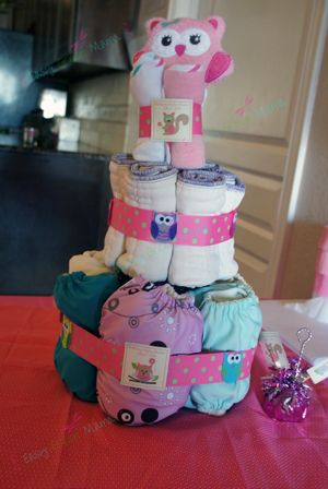 Baby Shower Cloth Diaper Cake for Owl Themed Baby Shower. Series of decorations ideas, diy crafts, products used, and more on Easy Green Mama.