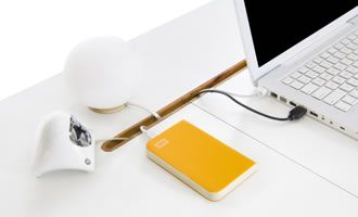 The top slides open so you can tick all your charging devices inside. Only one cord exits the desk.