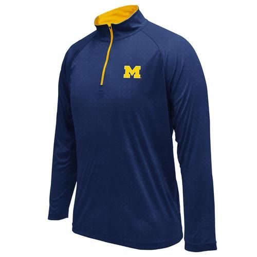 Michigan Wolverines Colosseum Athletic Gridlock Windshirt. This Michigan quarter zip long sleeve is made of 100% Polyester to ensure that perfect fit and athletic feel. The rival poly shirt has a unique geometric grid all-over design with rubberized print Wolverines logo on the left chest. The windshirt is both wind and water resistant and is perfect on the field or watching Michigan play ball. Show your team pride every day! Go Blue!!!