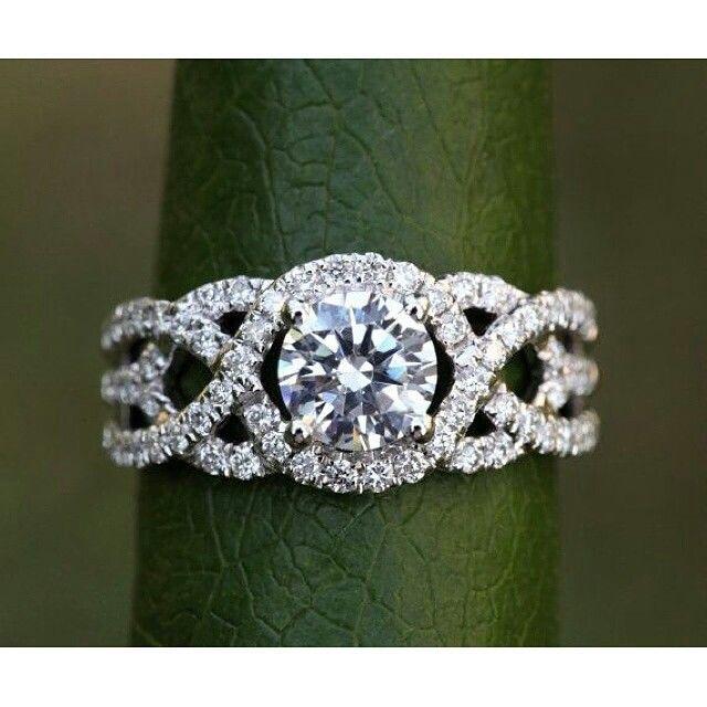 Entwined diamond brand with round center diamond. Wedding engagement ring via Aisle Perfect