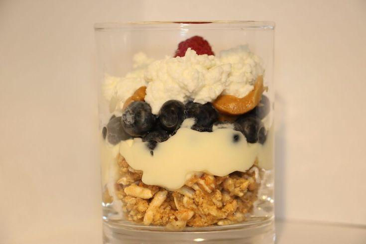 Healthy snack with crunchy granola, yogurt and riccota
