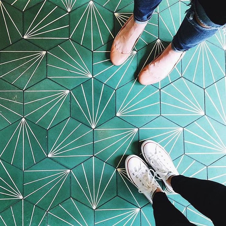 Teal hexagon floor tiles with a partial starburst geometric pattern, shared in #dsfloors