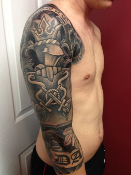 Family Crest Sleeve Tattoo - http://99tattooideas.com/family-crest-sleeve-tattoo/ #tattoo
