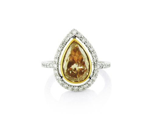 An 18ct White and Yellow Gold Fancy Brown Coloured Diamond Halo Ring