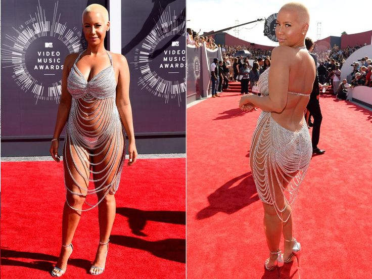 """Amber Rose is attending the awards as a guest of her rapper husband, Wiz Khalifa, but she is certainly the one stealing all the attention! The model leaves little to the imagination in draping crystal """"dress"""" with matching silver undergarments."""