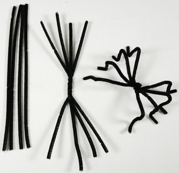 Easy-peasy pipe cleaner spiders.  Even small hands can manage this with a little direction from parents.  Using half-length pipe cleaners, the final product is great for games of tossing spiders onto giant cobwebs.
