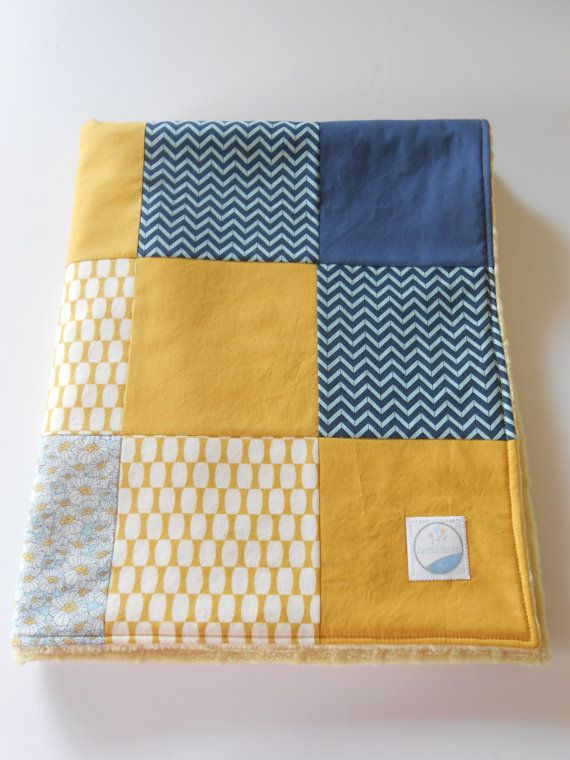 I call this my Mad Men patchwork baby blanket because the indigo and mustard colorways are very retro yet current! Blanket is constructed of Moda and other designer fabrics, interlined with Warm & Natural cotton batting and backed with ultra soft yellow minky from Shannon Fabrics. In my shop now.