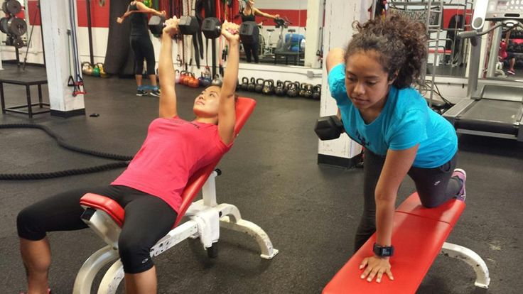 Perform a chest press and a bent over row to improve chest and back muscles.