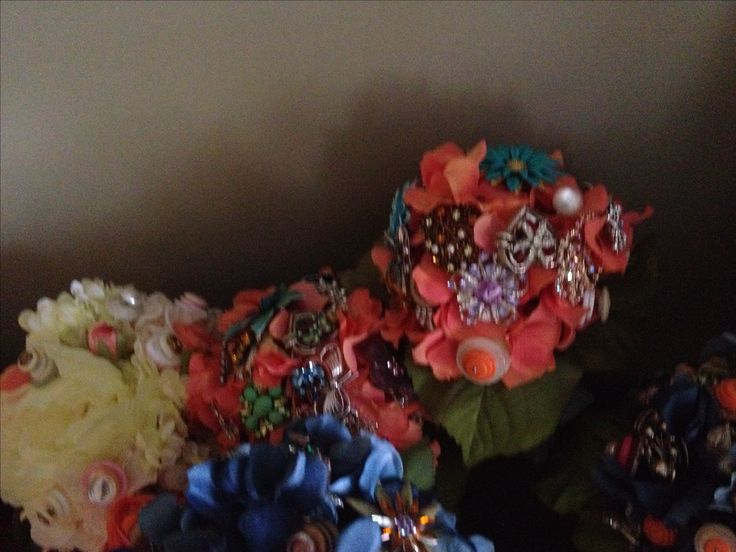 Broach and button bouquet. Ran out of antique broaches, added buttons to the bridesmaids bouquets.