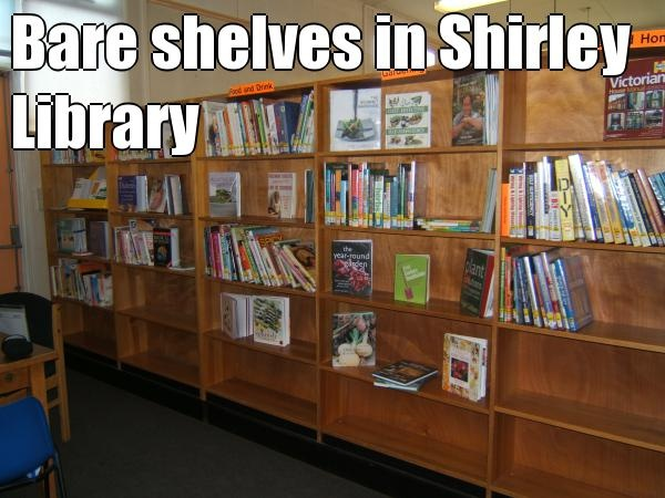 Bare shelves in Shirley Library  (courtesy of @Pinstamatic http://pinstamatic.com)
