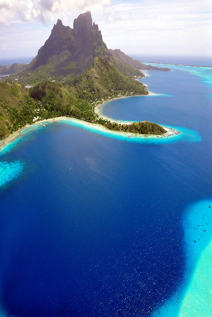 Amazing aerial view of Bora Bora and its lagoon  with its shades of blue © Mushi