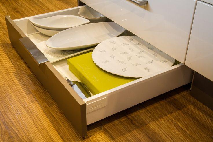 Kickboard drawers. Platter storage. www.thekitchendesigncentre.com.au