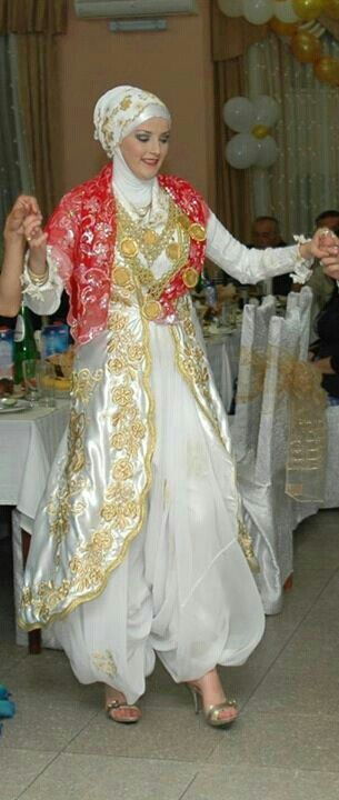 Hijab Balkan bride from Sandzak (Serbien)  in traditional clothes with red veil