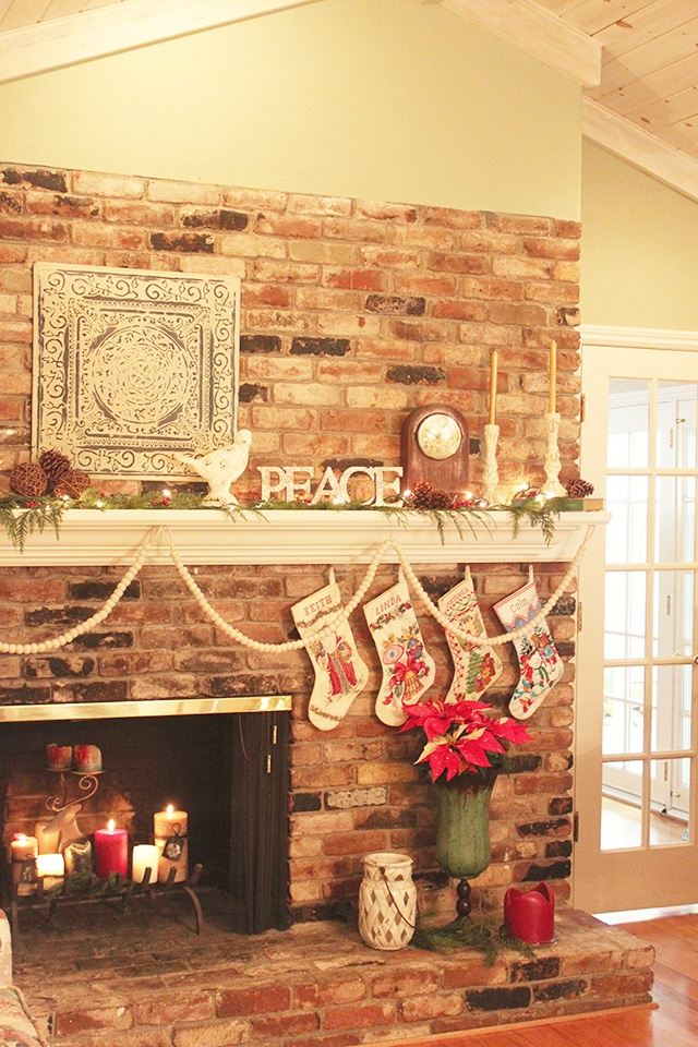 Merry Mantle - off center fireplace, I like the plant to the side, and candles