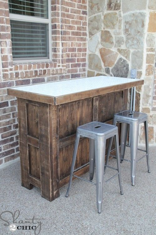 DIY- Wood outdoor or basement rec room bar with tile top.  A great place to entertain; doubles as a storage spot.