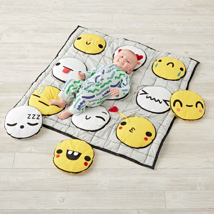 Encouraging endless exploration, our Emoji Baby Activity Mat is perfect for playtime. The faces have different multisensory features, including a rattle, squeaker and crinkly texture. Plus, there are 3 extra emoji faces that can be attached to the center. Designed exclusively for us by Michelle Romo.