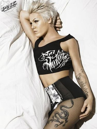 Pink's no stranger to ink and the Asian Dragon on her left thigh perfectly characterizes who this dynamic artist songstress is.. mythic!