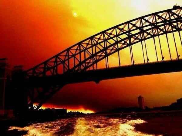 The skies above Sydney are scary. | 50 Surreal Images From Sydney's Bushfire Crisis...extraordinary shot of the harbour