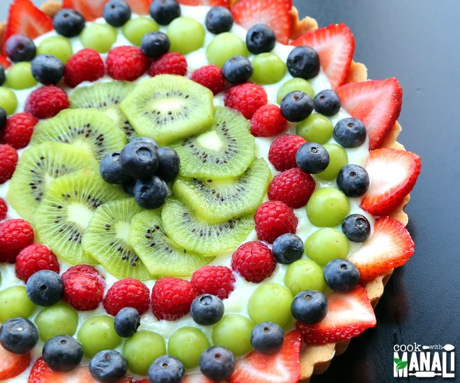 Shortbread crust tart filled with fresh fruits Find the recipe on www.cookwithmanali.com