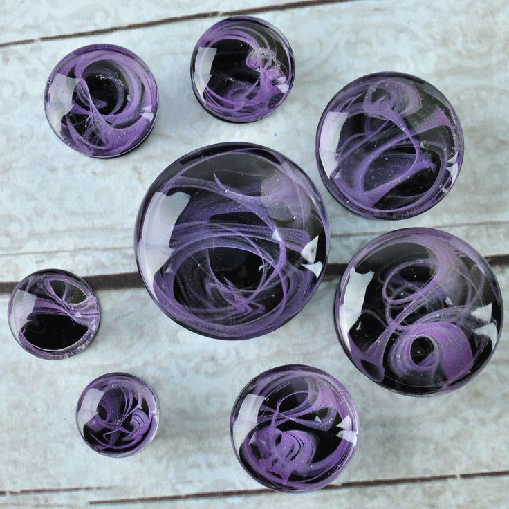 Purple Marble Swirl Glass Plugs Quantity: 1 pair (2 pieces) Material: glass Style: round cut plug Flare: double flare Length: 13 - 18mm Natural Material: SIZES ARE NOT EXACT; CAN BE +/- 1MM Natural Ma