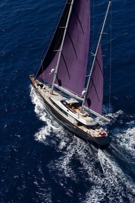 Yacht with purple sails
