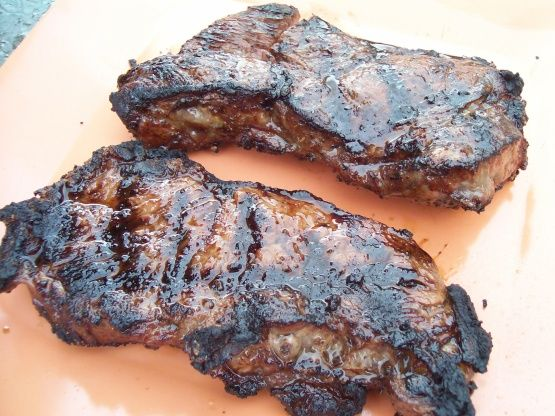 Tender juicy steaks on the grill are one of lifes pleasures. This is the best marinade we have ever come across. It is the perfect blend of flavors and it leaves the meat tender without being overpowering. Note: Im not sure of the origins of this recipe, I dont see a duplicate.  Will post a picture.