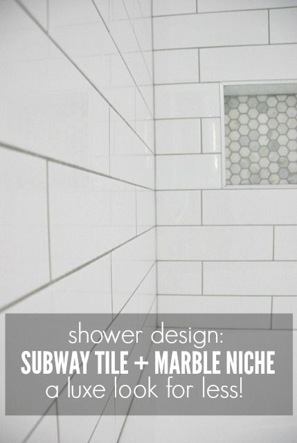Getting a luxe look for less! See how we used an elongated white subway tile with a marble hex tile niche in our bathroom design, all finished in a gray grout. The shower was tiled on a budget but looks super high end. Click over for the full tutorial!