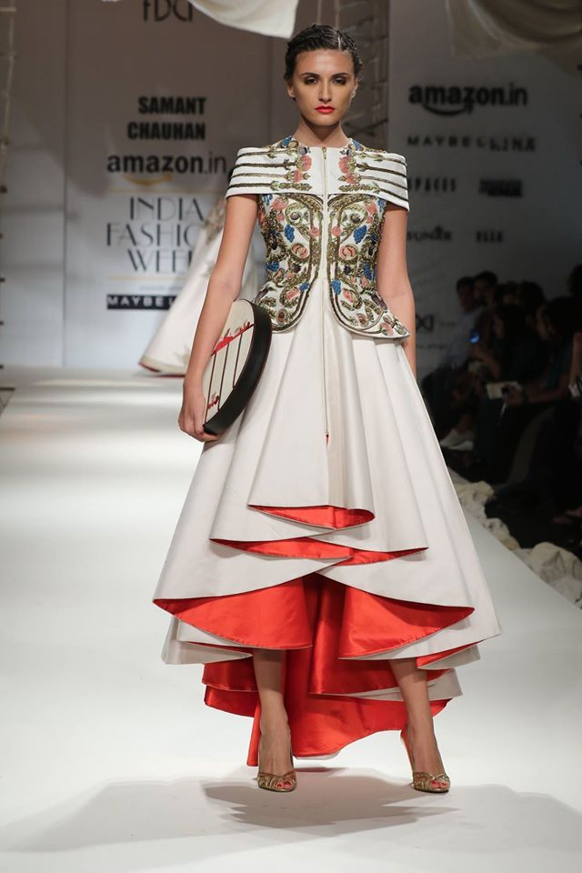 Kinnaur Queen relives through ‪#‎SamantChauhan‬'s brilliance in capturing the very essence of Indo-Greek regal cultural influences. Garments beautifully draped with golden beads and zarzodi work with contrast red piping mixed eloquently with mute thread work. Embellished with metal trims and leather belt with contrast stitch, colours like cherry and creme white radiated awe. ‪#‎AIFWSS16‬ Fashion Design Council of India's photo.