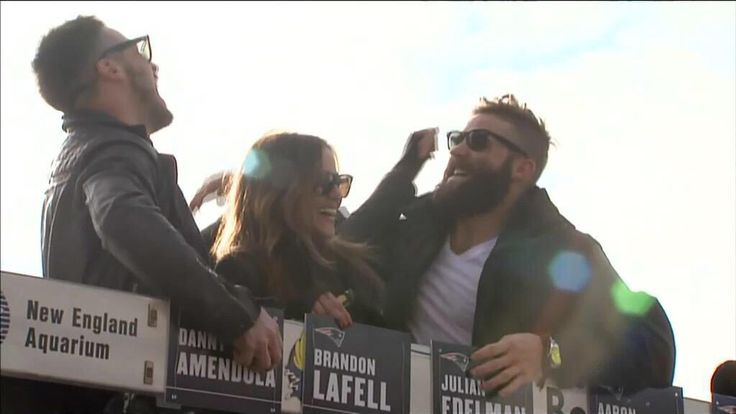 Danny Amendola, Kay Adams, and  Julian Edelman having a good time during the rolling rally for the @Patriots SB49 Champsm