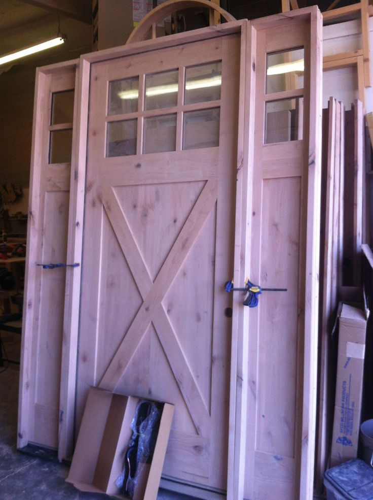 25 best ideas about entry door with sidelights on for Barn style exterior doors