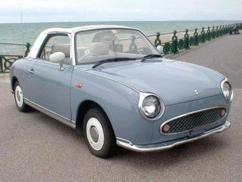 Nissan Figaro. I'd love to have one. Or two or three because I can't decide upon the color, grey, blue or green.... Would go nicely with my macarons!