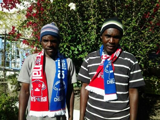 Paul and Ronald very happy with their Arsenal scarves they received in the post from our guests.