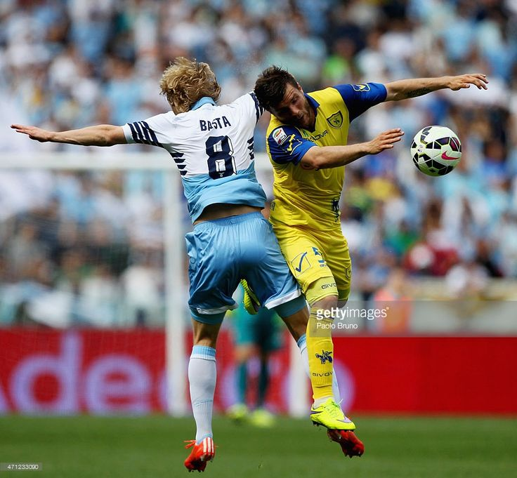 Dusan Basta (L) of SS Lazio competes for the ball with Perparim Hetemaj of AC Chievo during the Serie A match between SS Lazio and AC Chievo Verona at Stadio Olimpico on April 26, 2015 in Rome, Italy.
