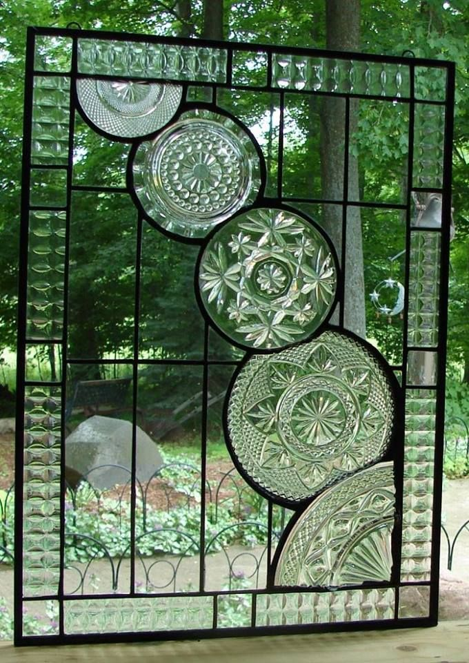 Beautiful window panel featuring vintage glassware