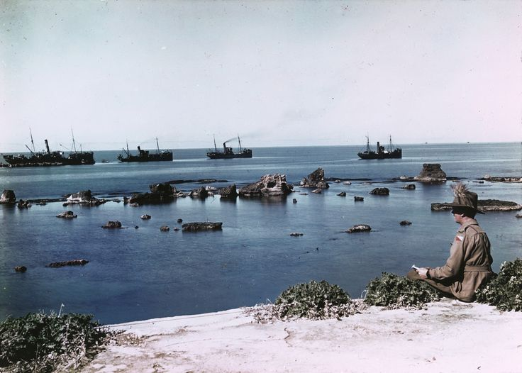 Photographer: Frank HurleyYear: UnknownLocation: Jaffa, PalestineDescription: An Australian soldier watches the transport ships off the coast near the Rocks of Andromeda in Jaffa, Palestine.Source: Mitchell Library, State Library of New South Wales