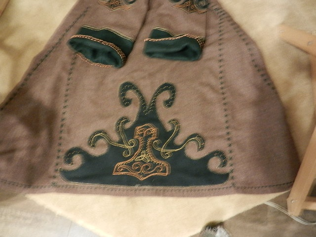 wool, linen lining, wool applique, hand embroidery.