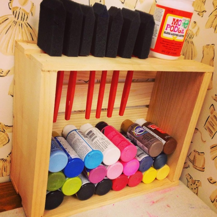 DIY paint/brush holder.. Get small wood crate at Micheal's for $3, turn on it's side, and fill with paints.. Slide brushes into groove at top!!
