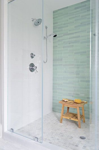 Sea green glass tile, white subway tile, frameless shower door, marble  mosaic floor