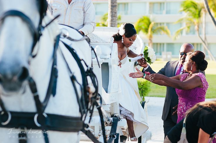 Bride exits the Cinderella carriage on her way to the wedding ceremony at Moon Palace Cancun #fairytalewedding