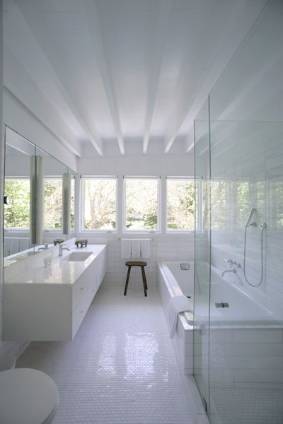 small bathroom - love the vanity & long tub - just needs double sink - FIRM: Carlos Brillembourg Architects with Karin Waisman | PRODUCT: Bianco Dolomiti