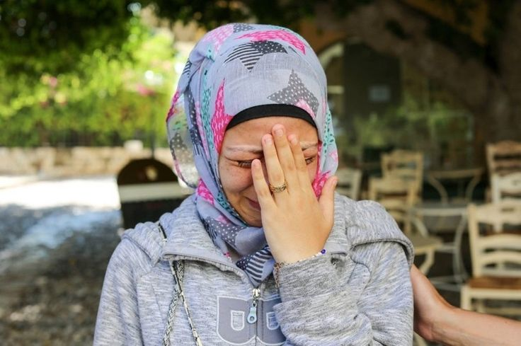 """... they never found my husband..."" Humans of New York went to Europe to see the refugee crisis firsthand. The photos are striking. Photo by Brandon Stanton/Humans of New York"