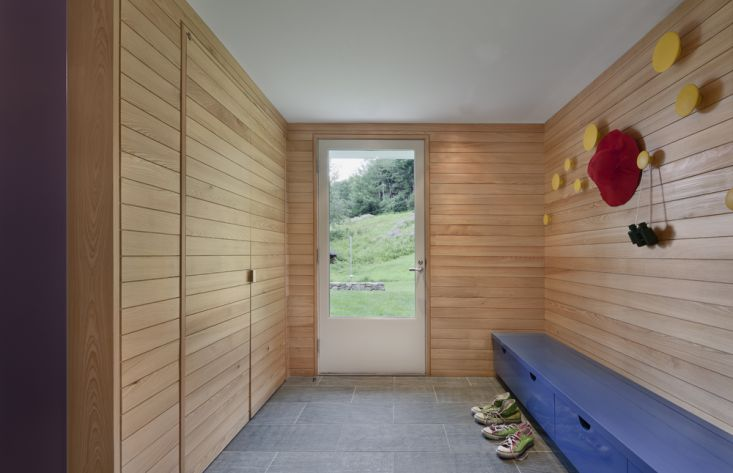 Modern mudroom with exterior cypress siding, yellow Muuto Dots, 18th century house by O'Neill Rose, Hidden Hollow, Remodelista