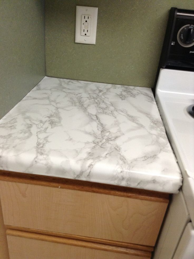 Using contact marble paper!  You can find it at Home Depot